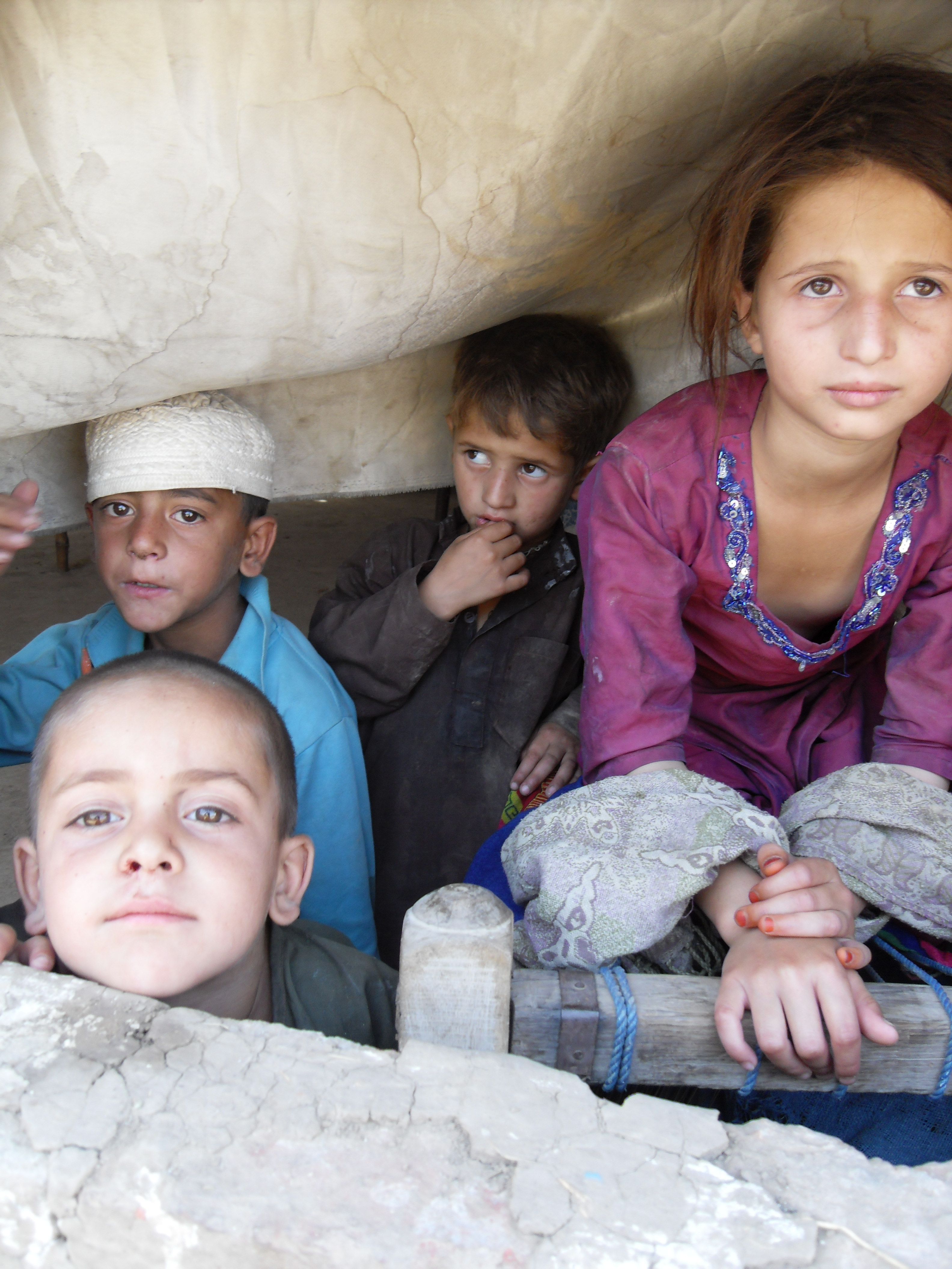 Refugees living in tent villages