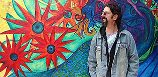Mark Zampella in front of a colorful wall.