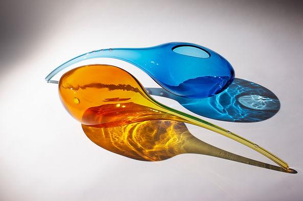 2 percussive glass sculptures