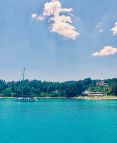 Visit Agora Beach by boat