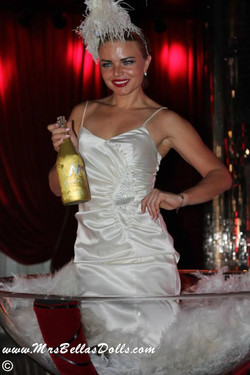 Champagne Dolls in glass