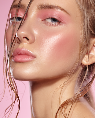 Woman with glowing skin. Woman with pink makeup.