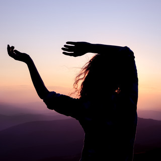 woman moving arms purple sky.jpg