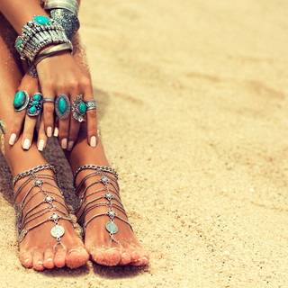 woman feet in sand jewels.jpg