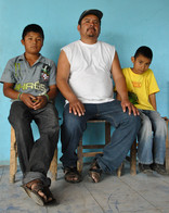 Don Justino and his sons. Anna Bruce cop
