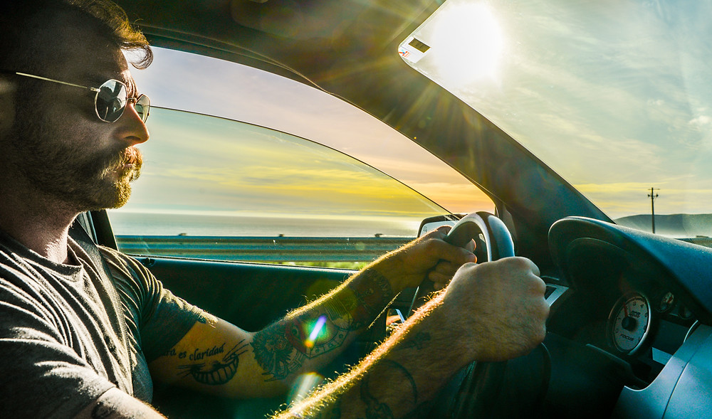Brooks driving along the coastal route from SLO to Cambria at Sunset