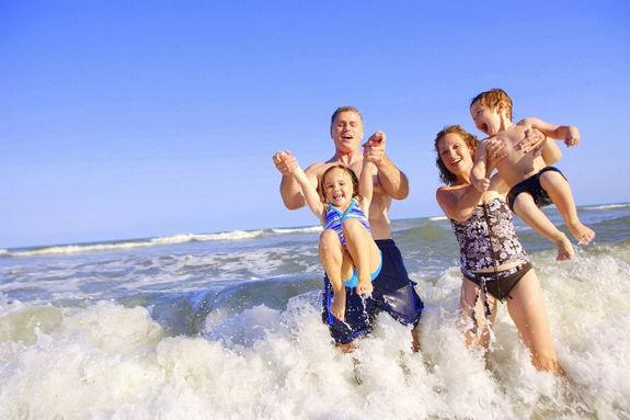 family_summer_beach_fun-696x464.jpg