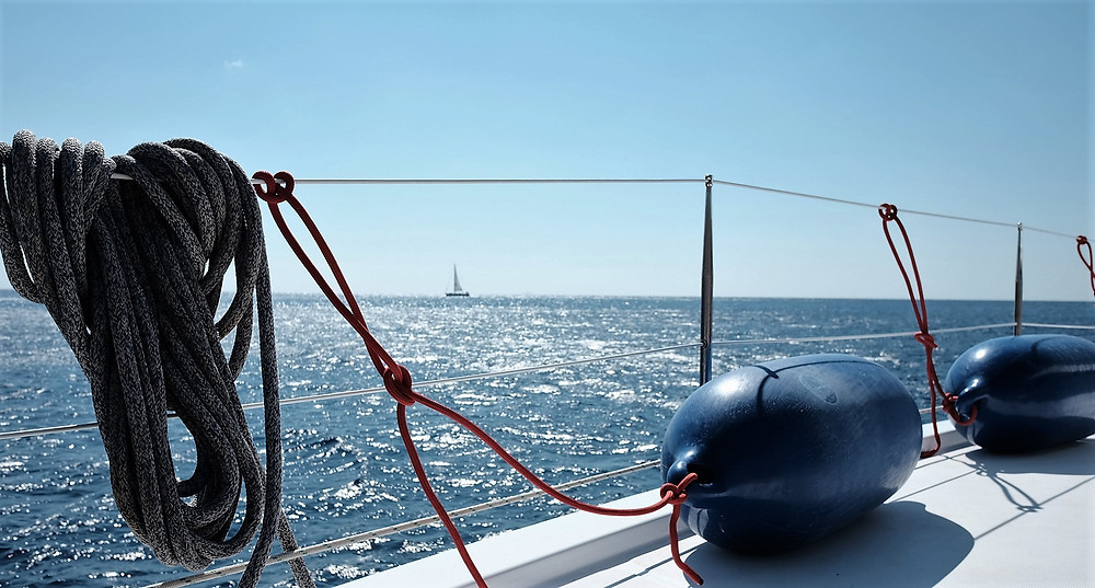 Sunny day on a charter sailboat in the Aegean Sea with an open sea view