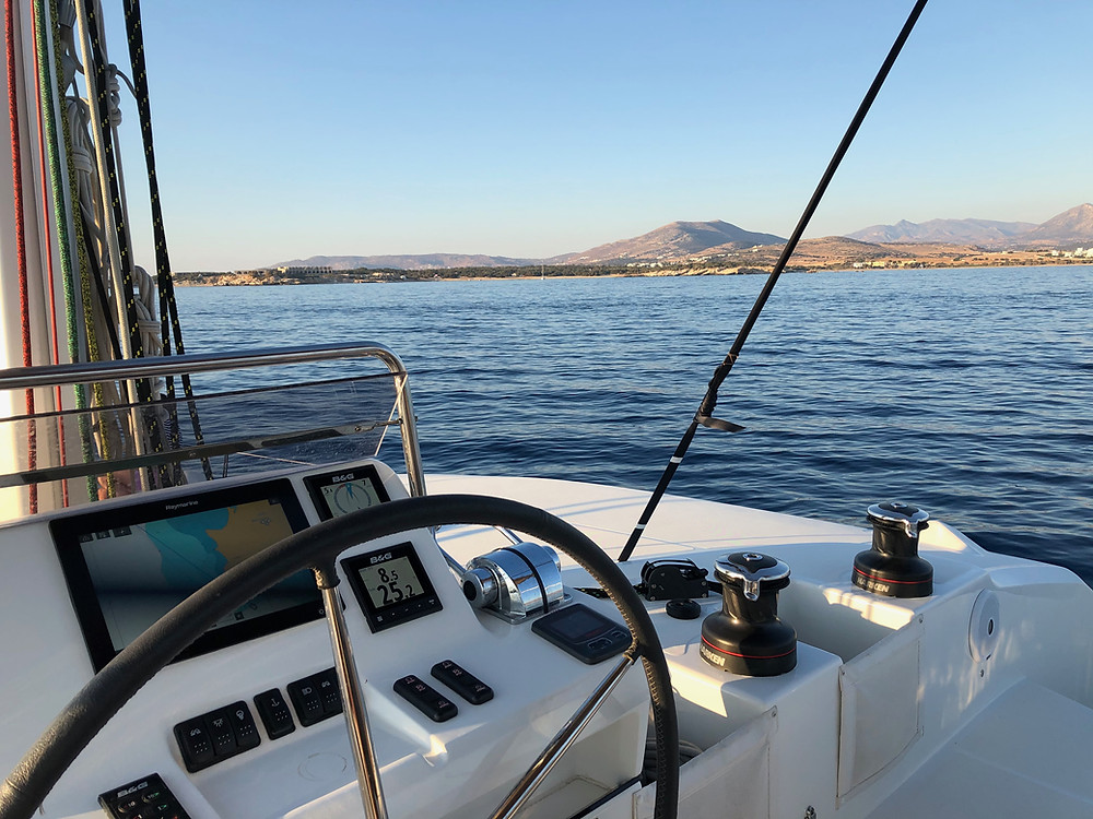 Sea view in the Cyclades from the flybridge of a new Lagoon 50 sailing charter catamaran