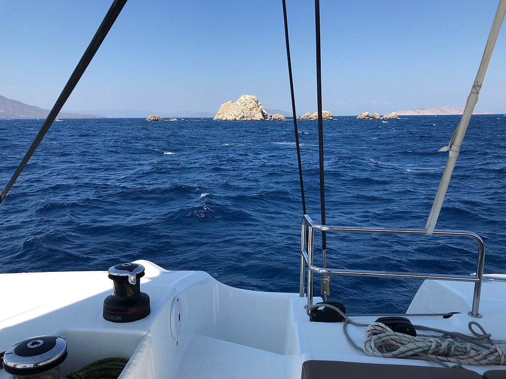 Flybridge view on a sailing skippered charter catamaran in the Cyclades, Greece