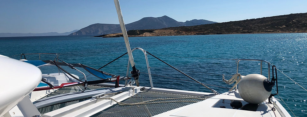 New Lagoon 50 bareboat catamaran charter at Minor Cyclades with sea view from bow