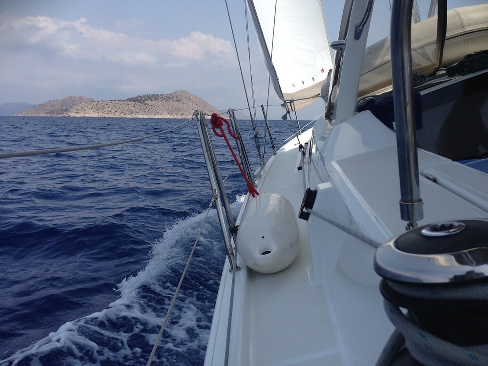 Monohull chartered in the ArgoSaronic, Greece heeling under full sails towards its next destination