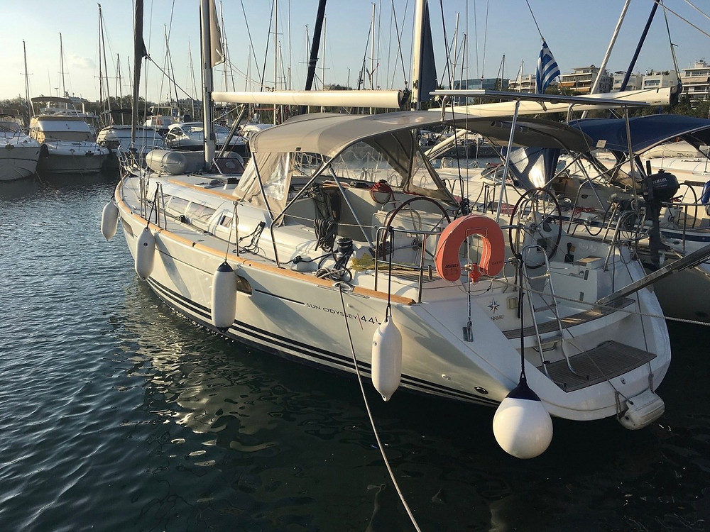 Lovely 4-cabin sailing charter monohull anchored at a Greek marina