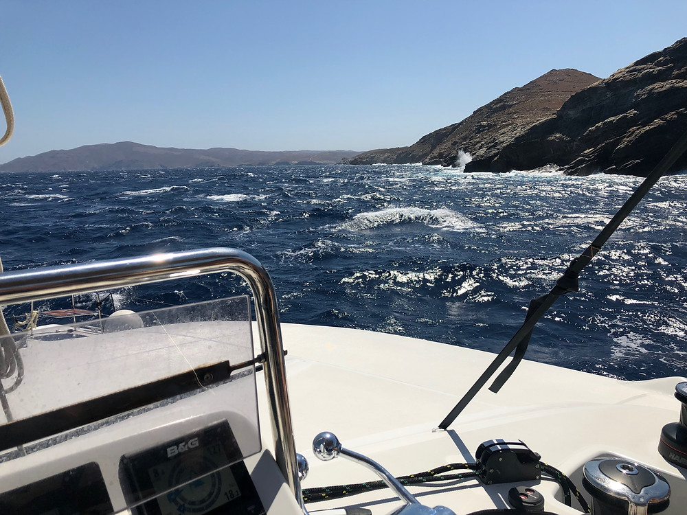 Flybridge view on a sailing catamaran chartered in the Cyclades in rough weather