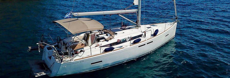 Sun Odyssey 419 monohull bareboat yacht charter sailing in Greece side view
