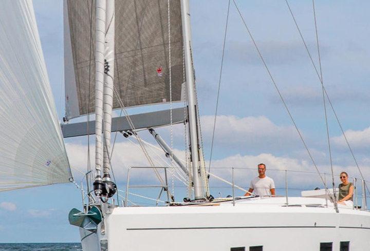 New Hanse 548 monohull bareboat sailing yacht front view at Rinia island charter