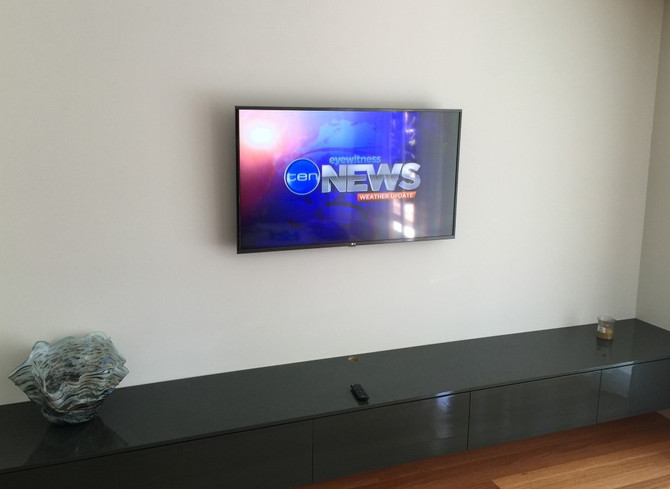 Got a new TV for Christmas?  Get it wall mounted to complete the Living Room makeover!