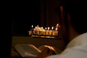 Lighting the menorah on the last night of Chanukah