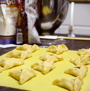 Rows of Purim hamantaschen ready to go into the oven