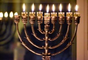 Oil menorah lit on the 7th night of Chanukah
