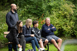 Gents Captain and family watch on