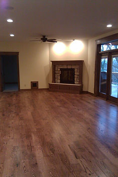 Wood floor with fireplace in a living area