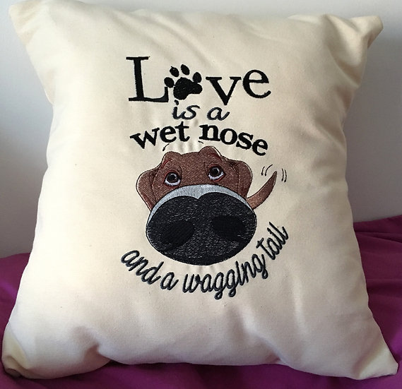 Love is a wet nose and a wagging tail cushion
