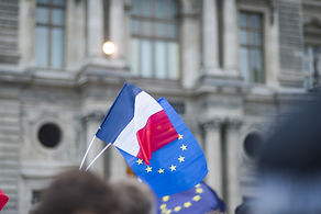 EU flags and France flags shown on a dem