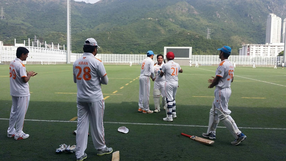 Jigar Parikh congratulated by his teammates after his century.