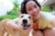 Asian woman selfie with dog.jpg