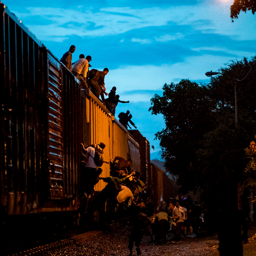 Undocumented migrants climb on a train known as 'La Bestia' in Las Patronas town, Veracruz state, Mexico, Aug. 9, 2018, to travel through Mexico and reach the U.S. Ronaldo Schemidt/AFP via Getty Images