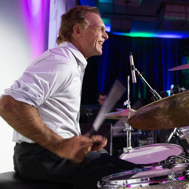 Doug Flutie on drums