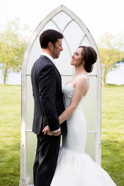 Wedding couple + church window