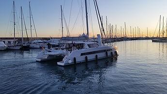 Catana 53 catamaran leaving port