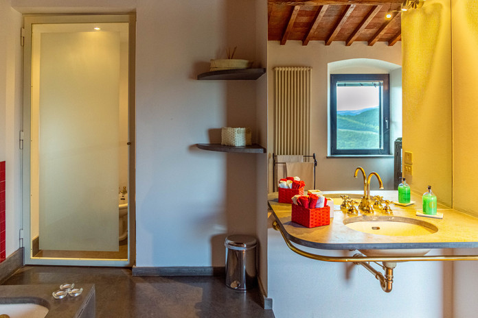 Bathroom with separate toilet and bidet