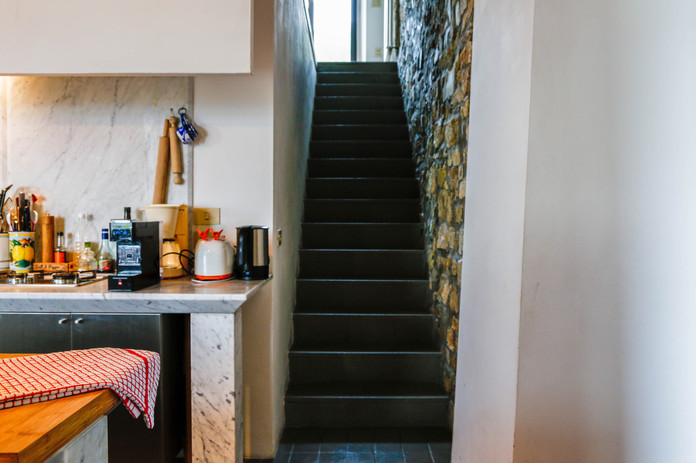 Staircase between entrance room and kitchen/ground floor