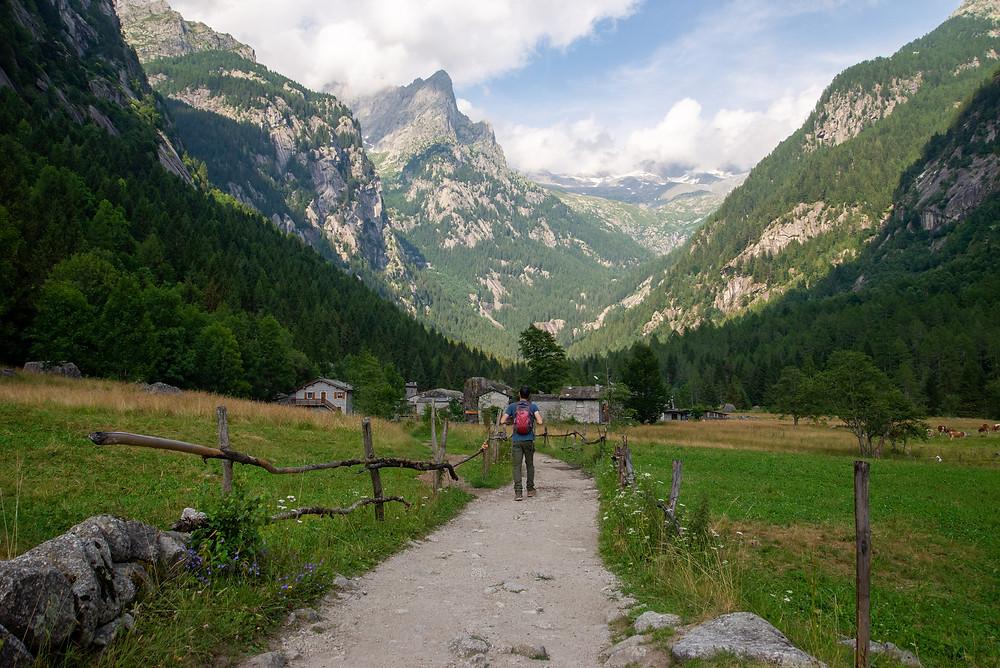 Hiker in Val di Mello in Italy.