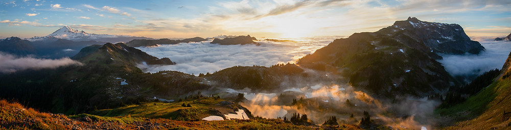 A panorama of Mount Baker and the Mount Baker Wilderness at sunset in Washington.