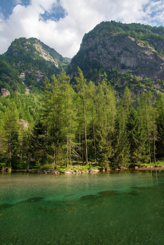 Lake under peaks in Val di Mello, Italy.