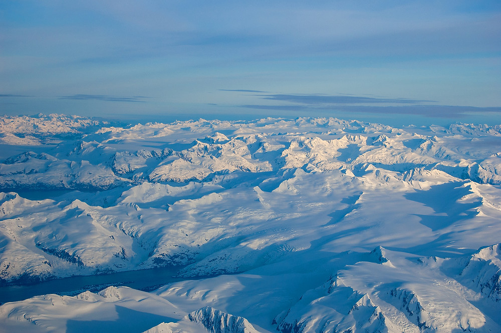The vast Alaskan wilderness as seen from a plane on a rare clear spring day.