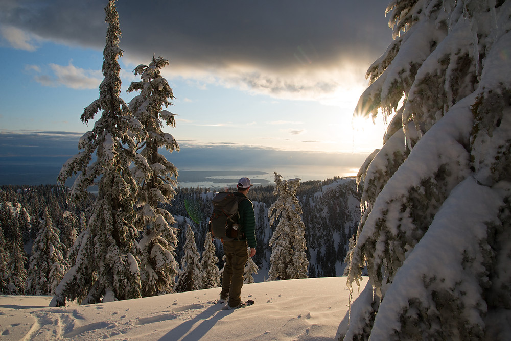 Enjoying sunset in the Coast Mountains of British Columbia. Vancouver sits far below.