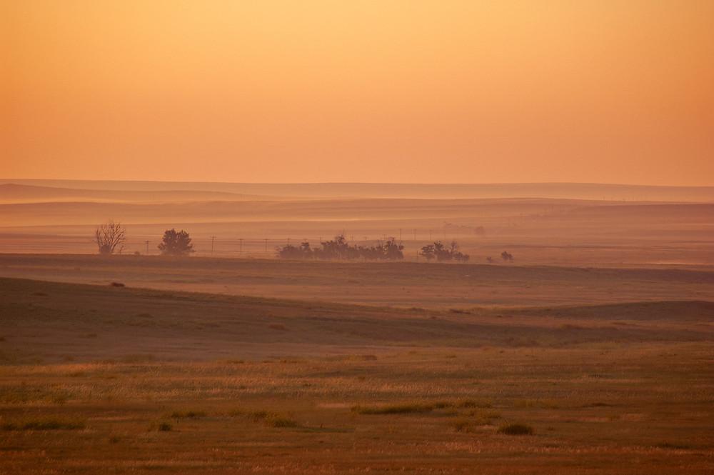 The rolling plains of South Dakota at sunrise.