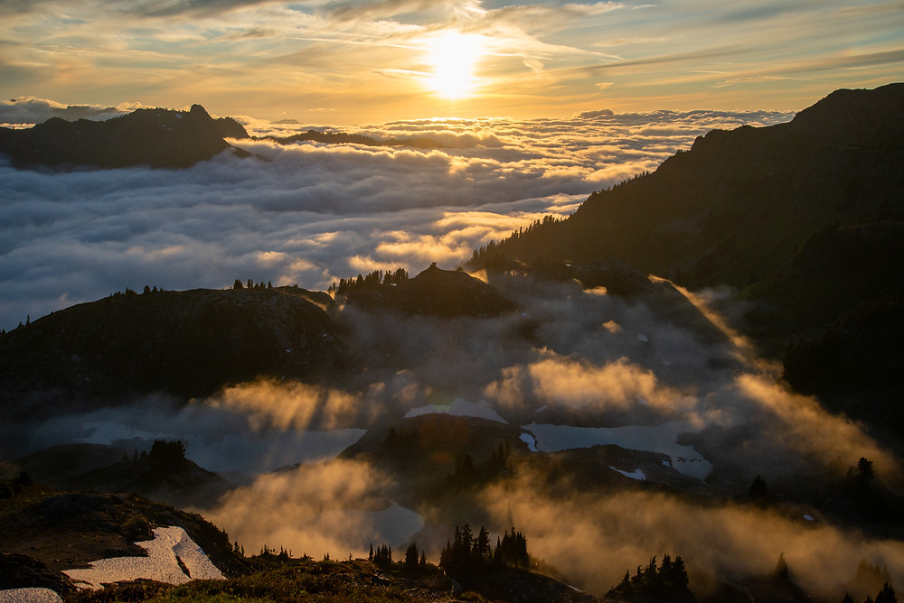 Sunset above the clouds in the Mount Baker Wilderness in Washington.