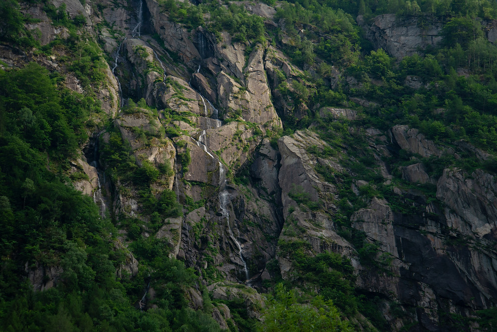 Waterfalls cascade in Val di Mello, Italy.