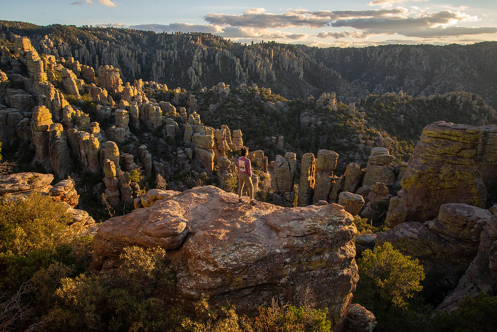 A hiker admires the rhyolite hoodoos in the canyons of the Chiricahua Mountains in Arizona.