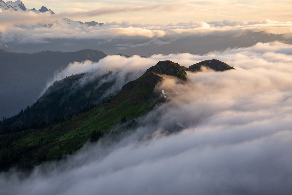 Clouds roll over a ridge in the Mount Baker Wilderness in Washington.