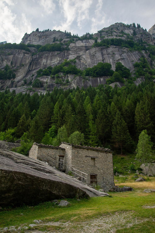 House built into rock in Val di Mello, Italy.