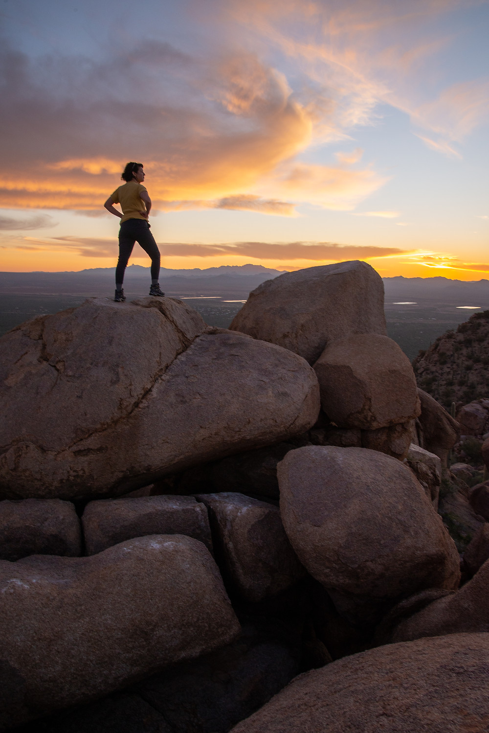 A hiker at sunset in Saguaro National Park in Arizona.