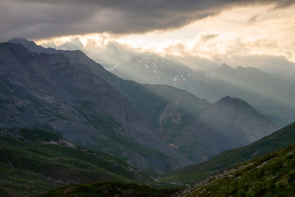 Sunset through the clouds high in the Alps of France.