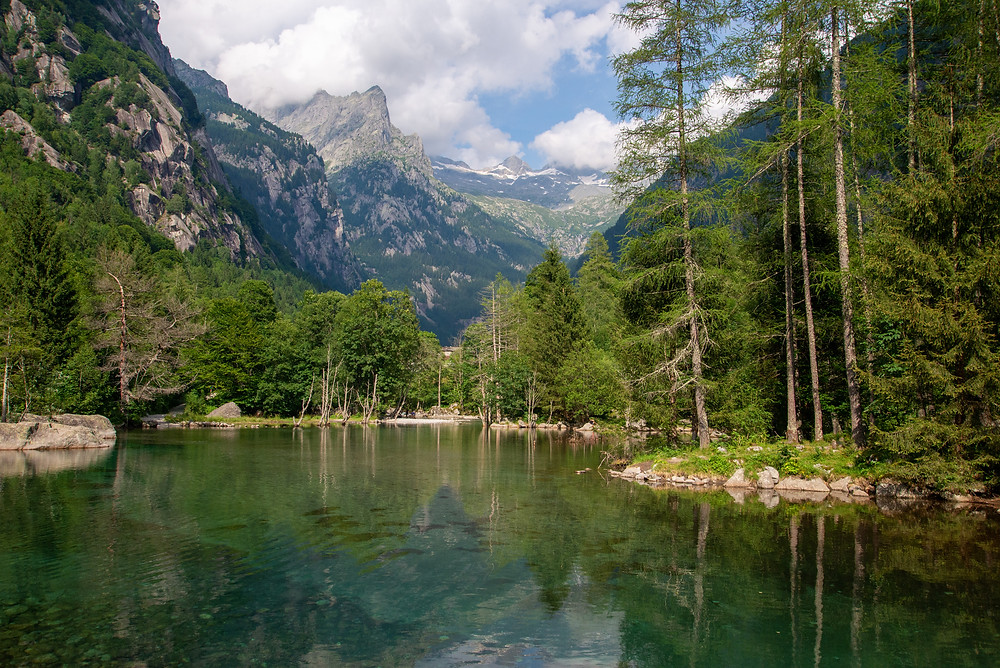 A lake in a forest in Val di Mello, Italy.